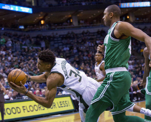 Giannis Antetokounmpo, Al Horford, AP photo