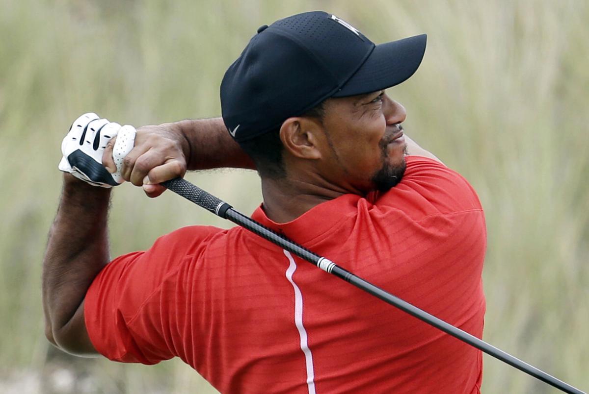 Tiger Woods swings December 2016, AP photo