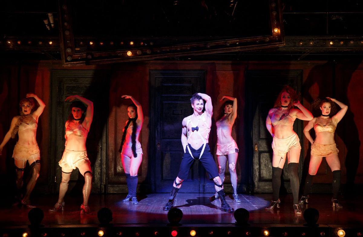 Cabaret emcee and cast