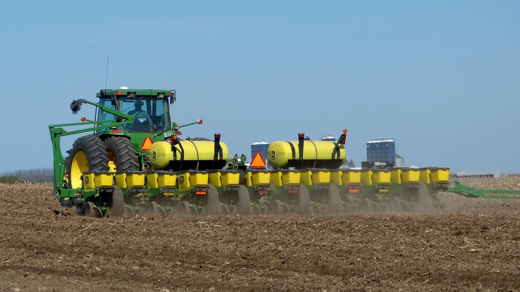 Tractor planting corn