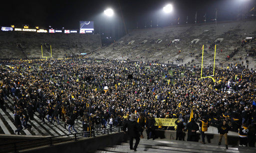 Iowa fans on field after beating Ohio State, AP photo