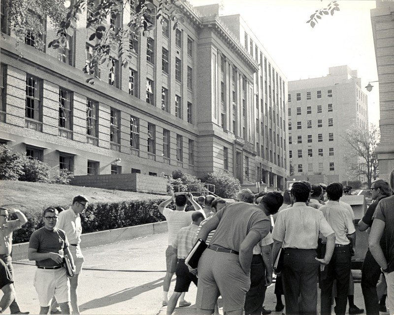 Bystanders look at aftermath of Sterling Hall bombing