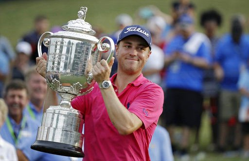Justin Thomas with PGA Championship trophy, AP photo