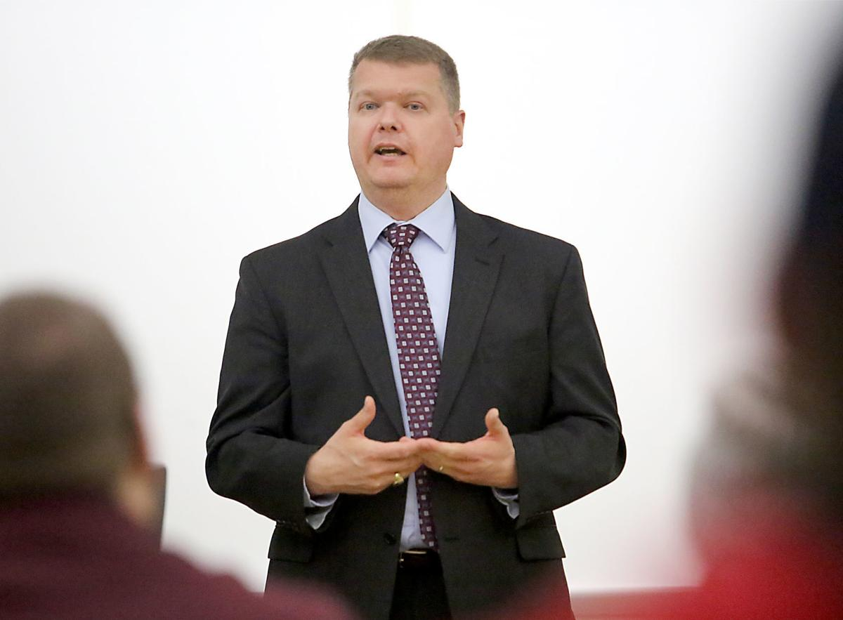 Michael Screnock chats with students