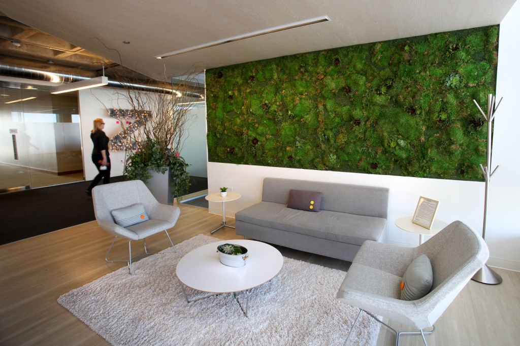 Zendesk a living moss wall anchors this startup that is for Zendesk office design