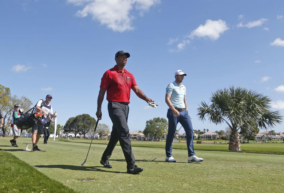 Tiger Woods walking, AP photo