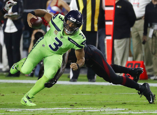 Russell Wilson, AP photo