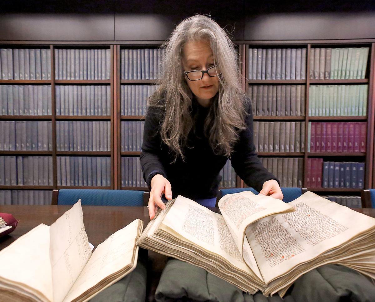Heather Wacha with old manuscript