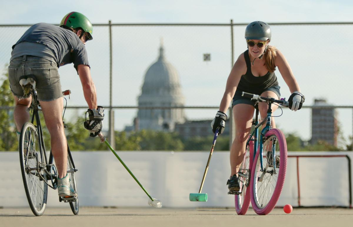 Two bike polo players