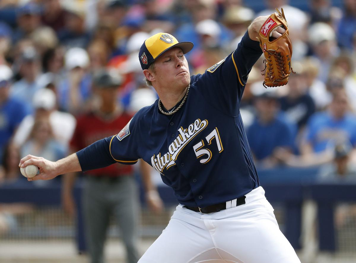 Chase Anderson pitching in spring, AP photo