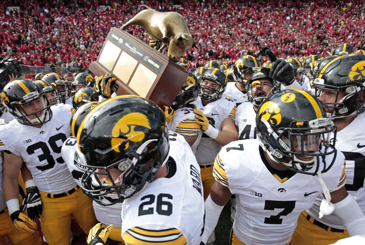 badgers football wisconsin looking to steal back heartland trophy