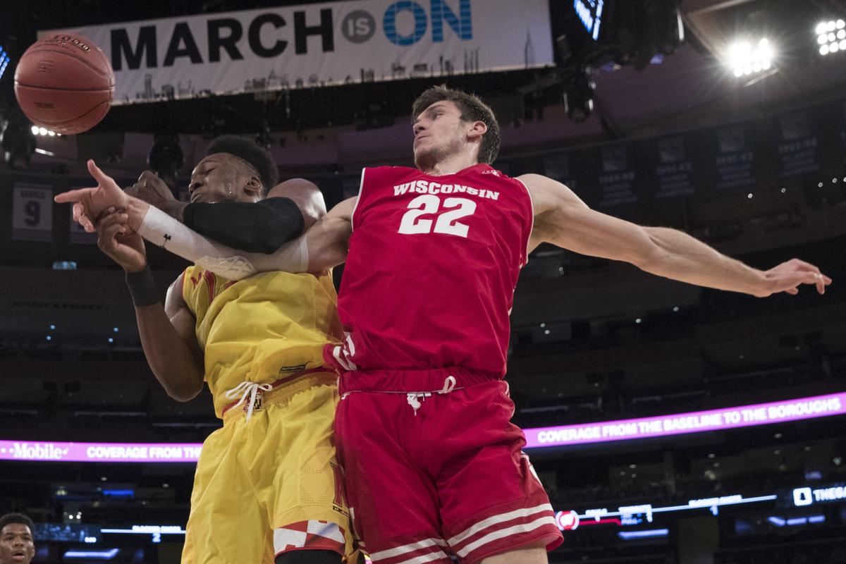 Ethan Happ fights for rebound, AP photo