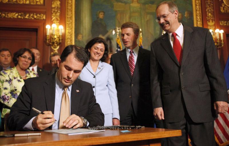 Walker signs ID bill