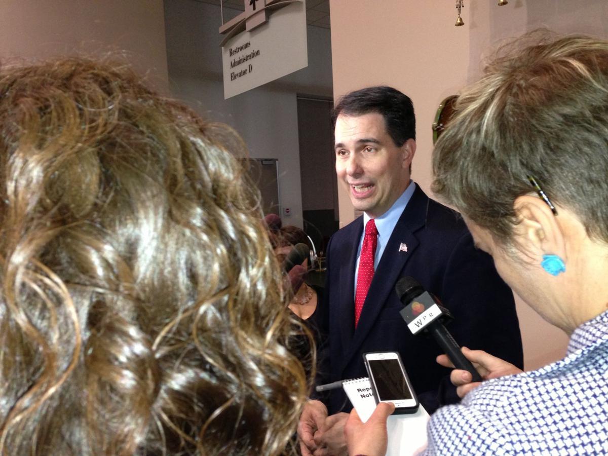 Walker speaks to reporters