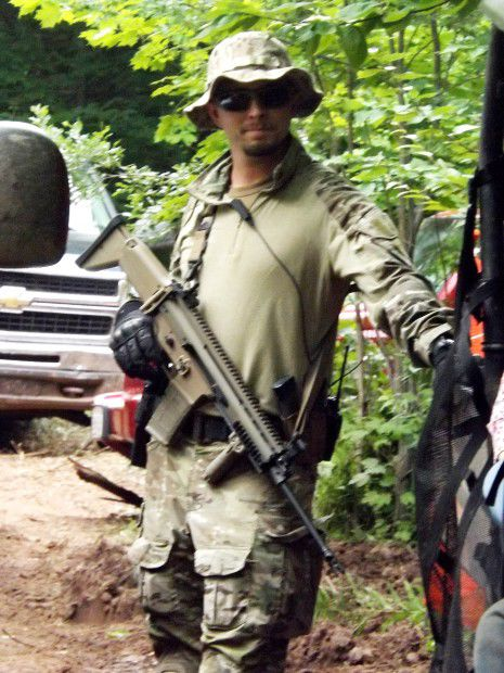 Security guard with high-powered rifle at mine site