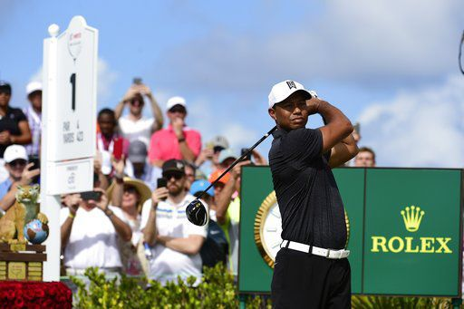 Tiger Woods tees off, AP photo