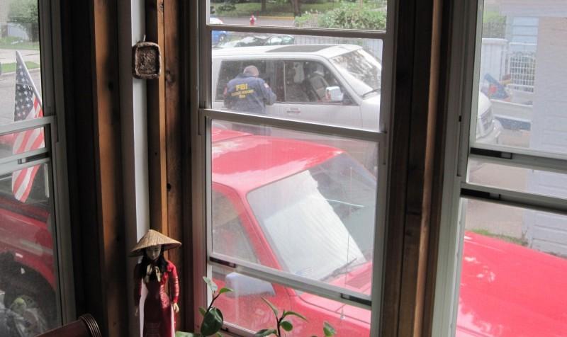 FBI agent searches SUV