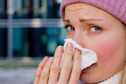 young female cold flu tissue sneeze istock file photo