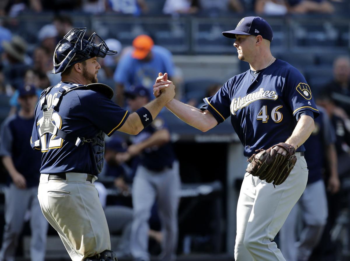 Stephen Vogt, Corey Knebel celebrate, AP photo