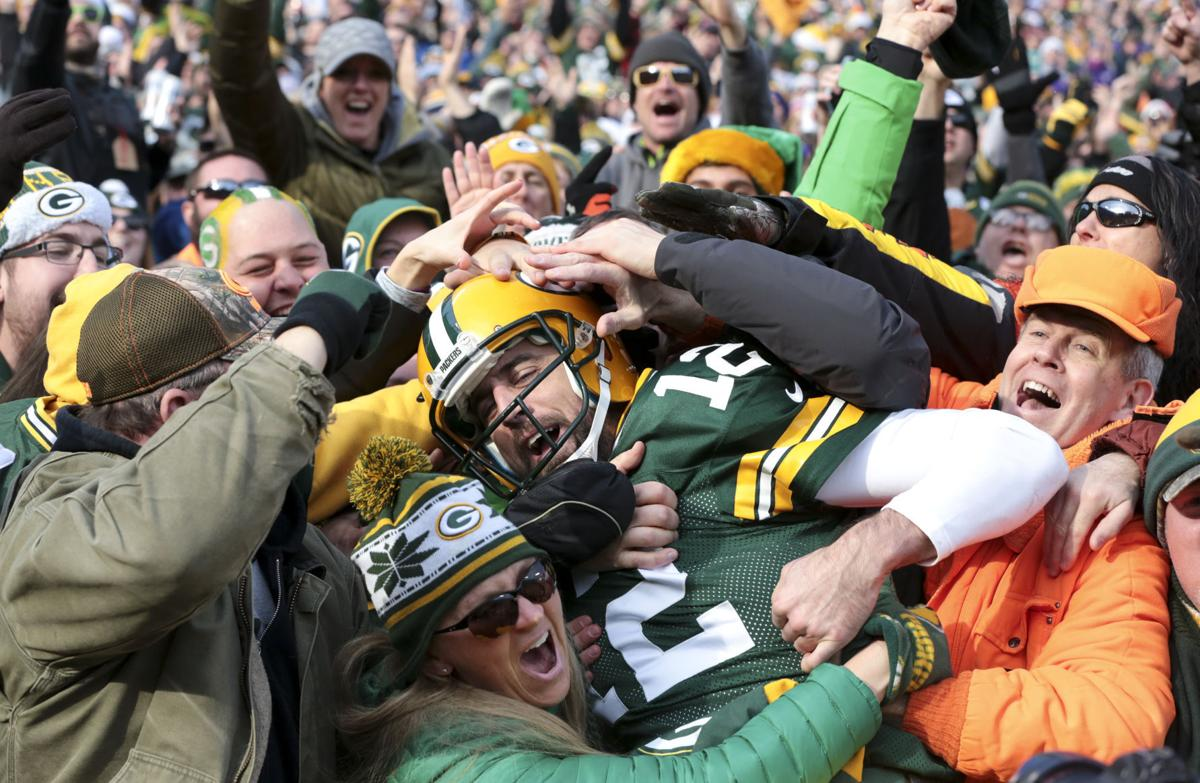 Aaron Rodgers-Lambeau Leap photo