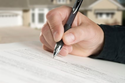 Title insurance mortgage document contract signature istock file photo