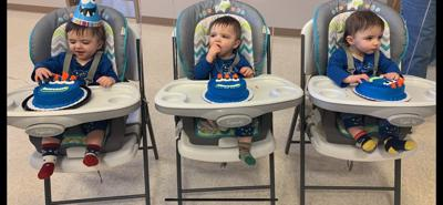 Identical triplets celebrate first birthday