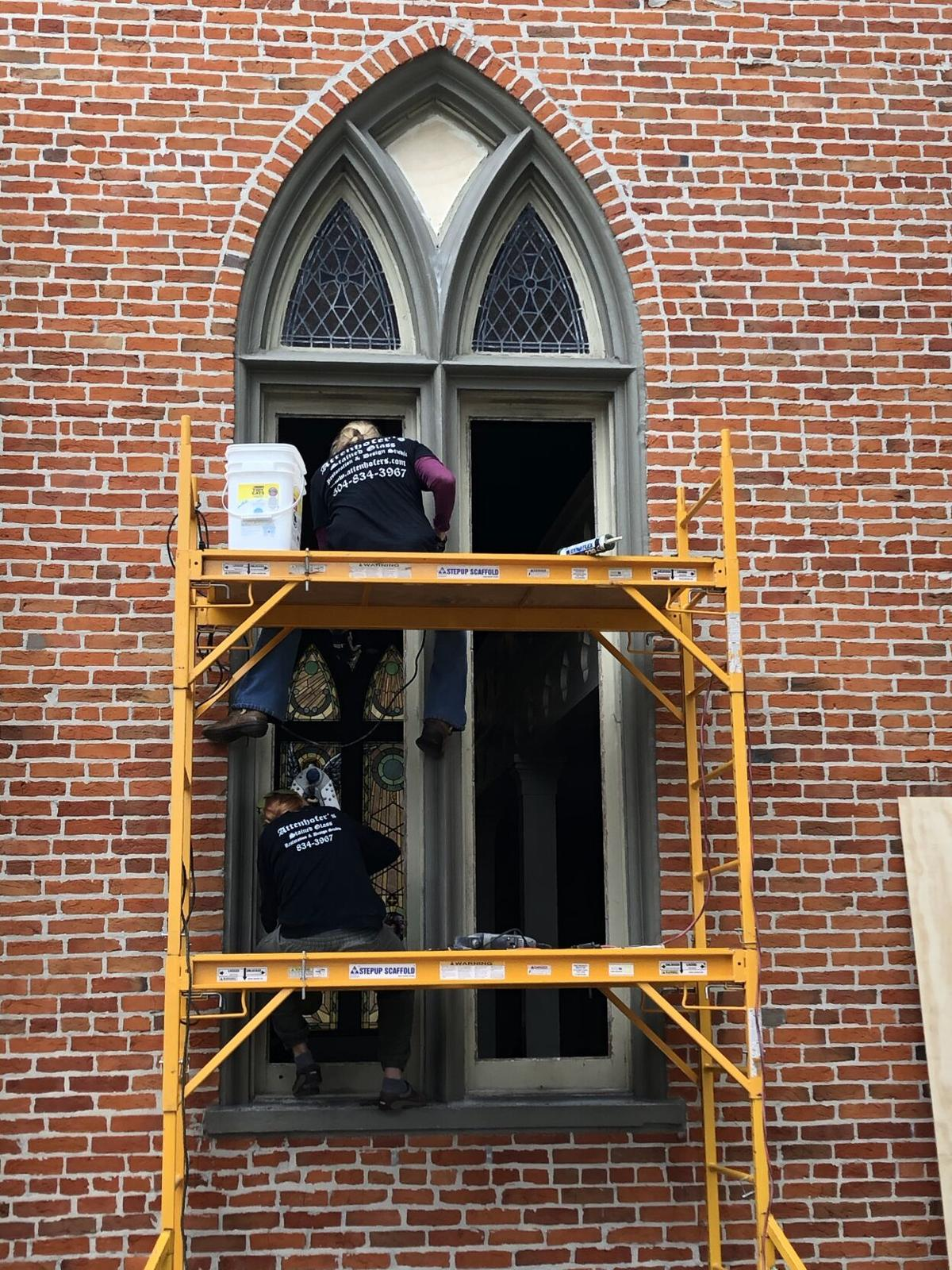 Crew working on stained glass