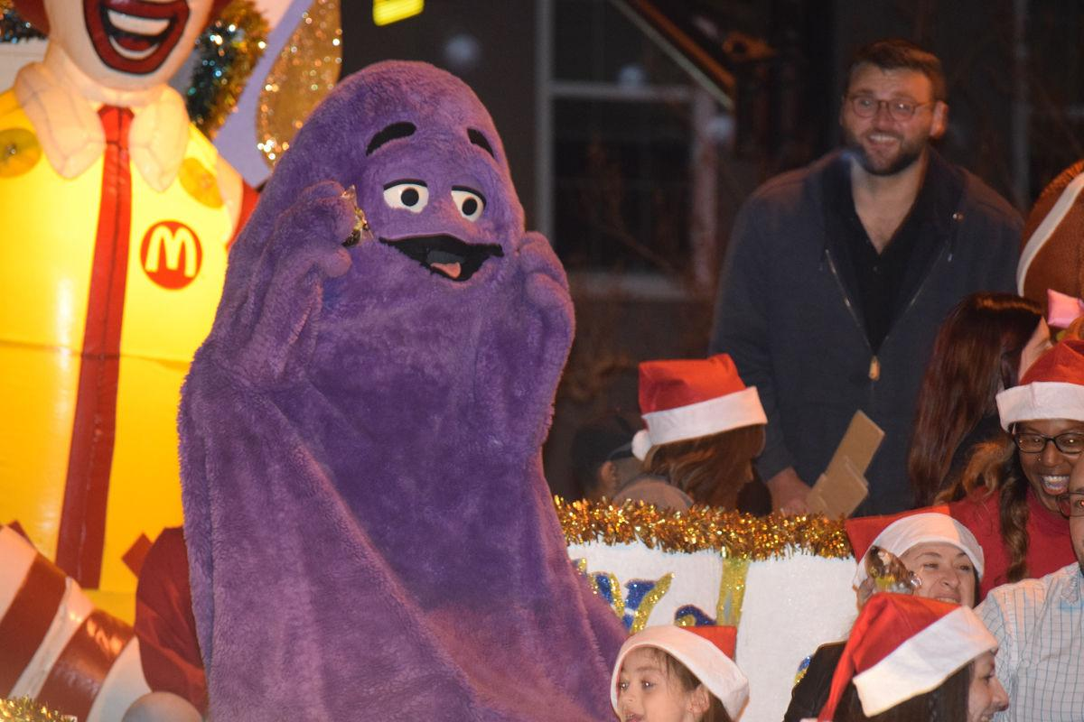 Colorful downtown parade has spirits up