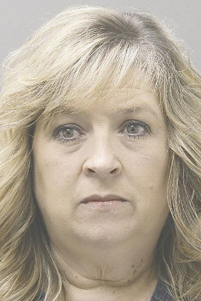 Woman arrested for helping take $500K from local company | Local