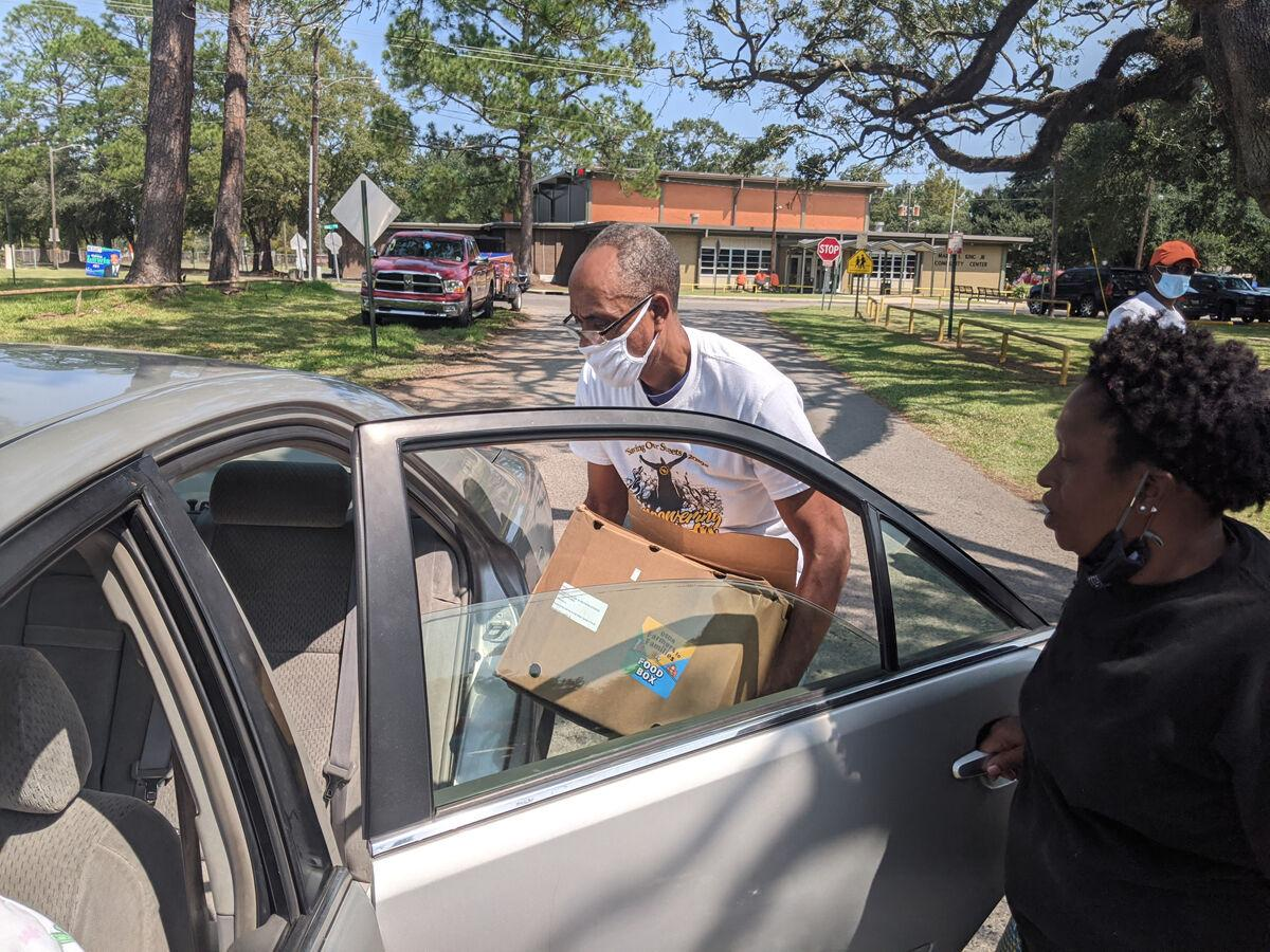 Volunteers with Life Grief Support Ministry distribute 500 food boxes