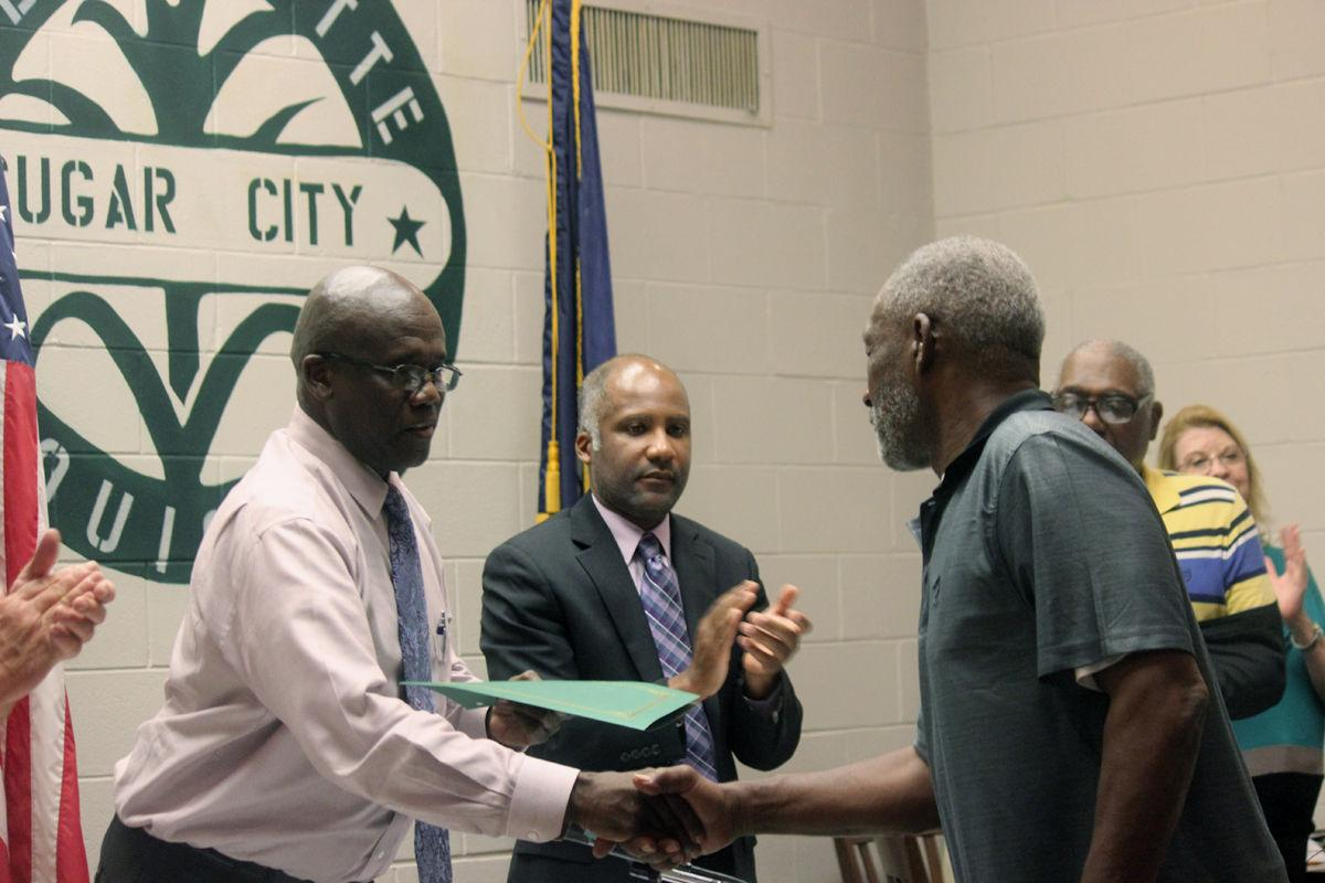 Packed house greets new mayor, board at first meeting