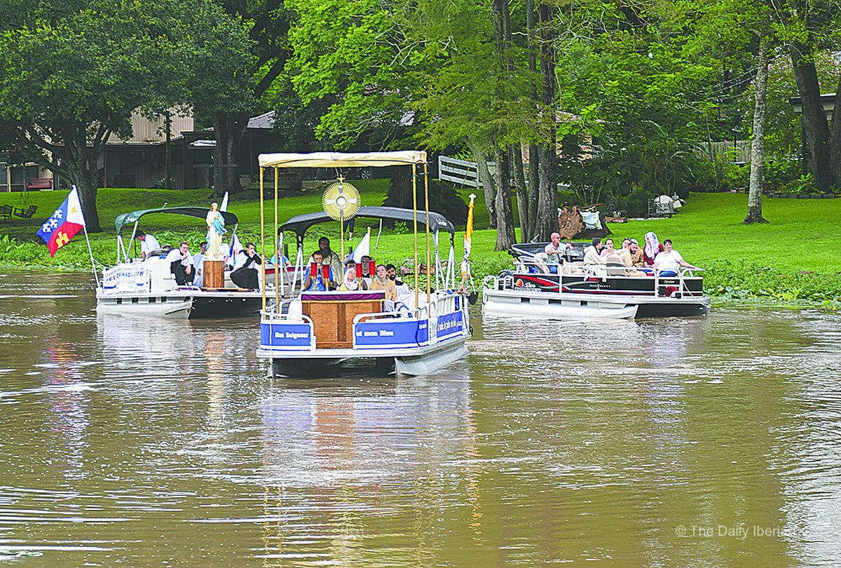 Carrying Christ: Eucharistic Procession down Bayou Teche draws crowd