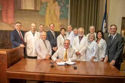 Mills touts savings on Medicare, prescription benefits