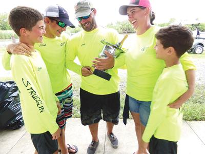 OVERTIME OUTDOORS:Mild-mannered trash talking on the winning boat