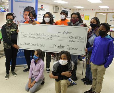 Spencer donates $5,000 to Boys & Girls Club