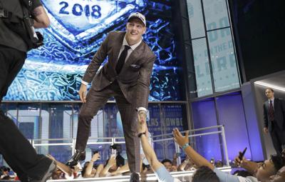 NFL Draft Football. Buy Now. Boise State s Leighton Vander Esch walks onto  the stage after being selected by the Dallas Cowboys during the first ... 4bf5f6971