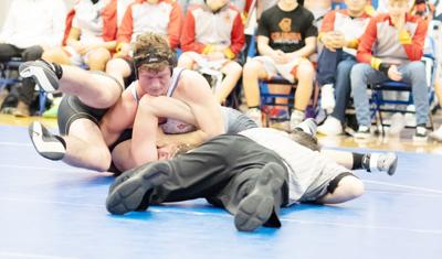 Dalton, Johnson continue to lead wrestlers