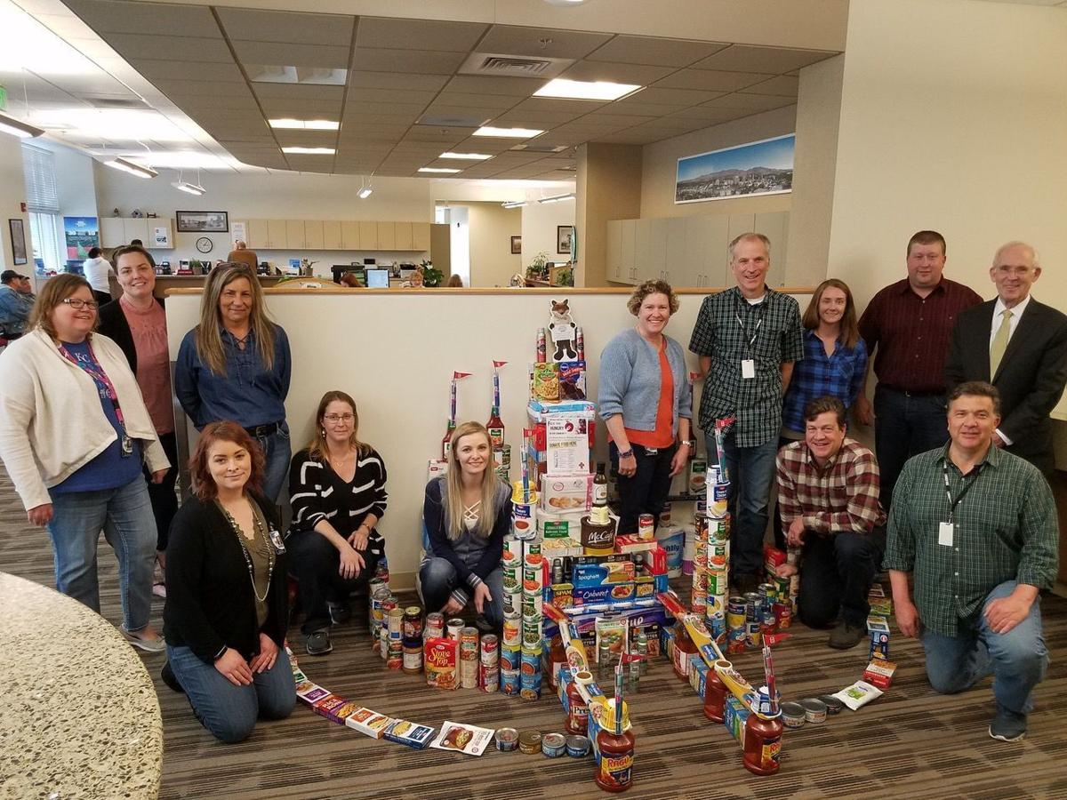 March To End Hunger participants pose with their Can Castle