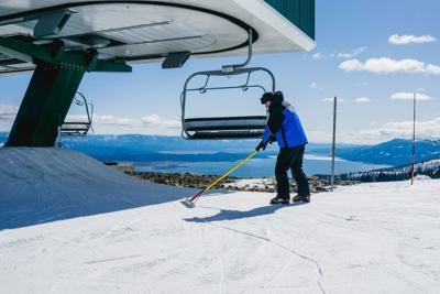 Tamarack employee at work at top of lift