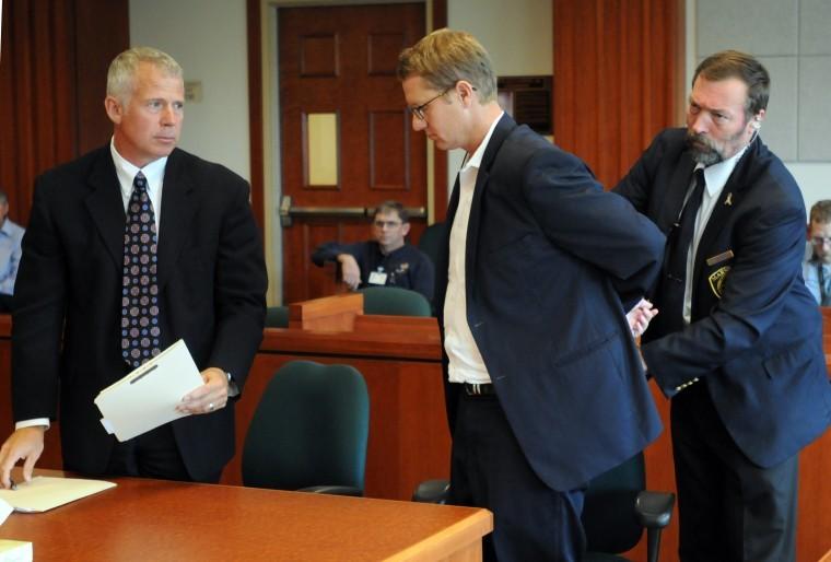 John McGee handcuffed