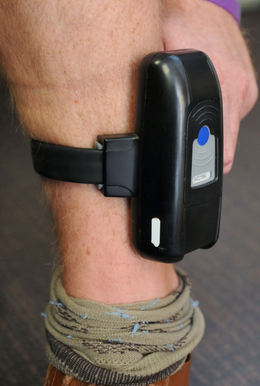 electronic ankle being adult monitoring nebraska aka fitted parole with parolee bracelet lincoln stock photo device