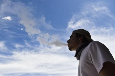 A vaper exhales a cloud of vapor in Helena