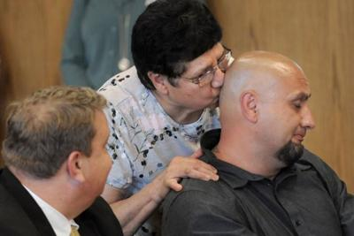 Christopher Tapp exonerated mom kiss 7-17-19