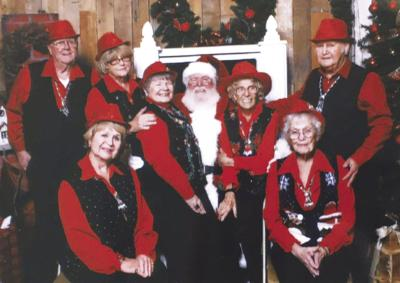 Prime Time Swingers pose with Santa