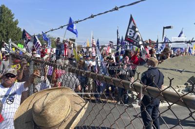 Biden Idaho AP photo of protest outside NIFC gte
