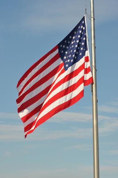 Memorial American flag flys high