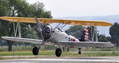Biplane landing at Sawyer Field