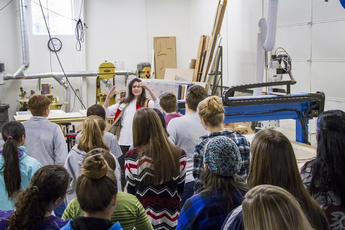 Girls gather in the shop at the Discovery Center