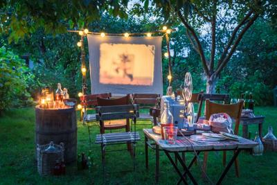 Open-air cinema with drinks and popcorn in the garden