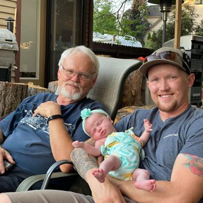 Rod Russell with his son and granddaughter